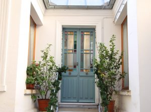 porte 2 vantaux avec vitraux